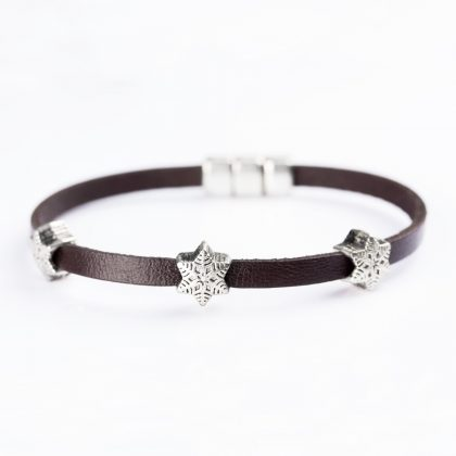 bracelet made from brown leather with star shaped steel beeds